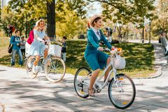 Kiev Ukraine Retro Cruise May 2018. Kiev, Ukraine - May 12, 2018: Group of people in retro clothes participating in bicycle tweed run Retro cruise on May 12 Stock Image