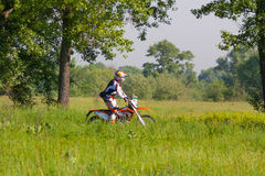 Motocross rider. KIEV, UKRAINE - MAY 12: Motocross rider rides in the green areas of the Park Druzby Narodov Royalty Free Stock Photo
