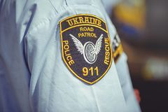 Police patch on the shirts of the shirt in the framework of the security day in Kiev. Kiev, Ukraine - MAY, 2017 : police patch on the shirts of the shirt in the Royalty Free Stock Photo