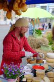 KIEV, UKRAINE - MAY 19, 2018: The seller of cheese at the traditional street fair of a variety of natural organic products Royalty Free Stock Images