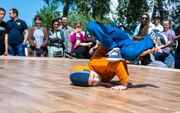 KIEV, UKRAINE - MAY 28, 2017: Street artist breakdancing outdoors Stock Photo