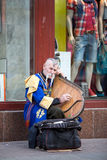 KIEV, UKRAINE - MAY 03, 2013: Street musician in the image of cossack in the national costume plays on gusli Stock Photography