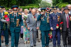 Kiev, Ukraine - on May 09, 2016: Veterans of World War II lay flowers in the park. Of eternal glory in an anniversary of the victory Royalty Free Stock Photography