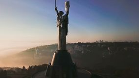 Kiev Ukraine the most popular tourist places to visit The Motherland Monument. Aerial drone video footage of huge steel. Statue of woman with shield and sword stock video footage