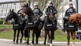 Kiev, Ukraine - 04.14.2019. Mounted police. A crowd of Ukrainians are going to the stadium to support the presidential candidate stock image