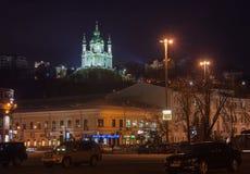 KIEV, UKRAINE: Night lights in Kyiv Podil. KIEV, UKRAINE - MARCH, 23, 2017: Illuminated St. Andrew`s Church and Sagadachna Street in Podil in Kiev, Ukraine Royalty Free Stock Images