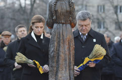 KIEV, UKRAINE - Nov 28, 2015: President of Ukraine Petro Poroshenko and his wife commemorated the victims of the famine-genocide Stock Photography