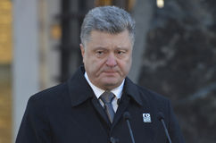 KIEV, UKRAINE - Nov 28, 2015: President of Ukraine Petro Poroshenko and his wife commemorated the victims of the famine-genocide Royalty Free Stock Photos