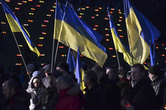 KIEV, UKRAINE - Nov 28, 2015: Ukrainians Commemorate 1932-1933 Great Famine. Ukrainians light candles during a memorial ceremony near a monument to the victims Royalty Free Stock Photo
