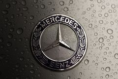 Kiev, Ukraine - 03 NOVEMBER, 2017: Close-up emblem of modern luxury Mercedes-Benz car with grey wet hood.  Stock Images