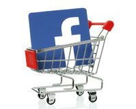 Facebook icon placed into shopping cart royalty free stock image