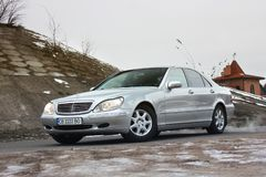 Kiev, Ukraine - November 22, 2018: Mercedes-Benz S-Class in winter against the background of houses royalty free stock image