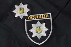 KIEV, UKRAINE - NOVEMBER 22, 2016. Patch and badge of the National Police of Ukraine on black uniform background. KIEV, UKRAINE - NOVEMBER 22, 2016. Patch and stock image
