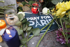 KIEV,UKRAINE - November 14, 2015: People lay flowers at the French Embassy in Kiev in memory of the victims terror attacks in Pari. People lay flowers at the stock photo