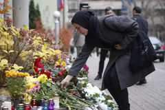 KIEV,UKRAINE - November 14, 2015: People lay flowers at the French Embassy in Kiev in memory of the victims terror attacks in Pari Royalty Free Stock Photos
