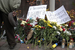 KIEV,UKRAINE - November 14, 2015: People lay flowers at the French Embassy in Kiev in memory of the victims terror attacks in Pari Royalty Free Stock Photography
