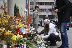 KIEV,UKRAINE - November 14, 2015: People lay flowers at the French Embassy in Kiev in memory of the victims terror attacks in Pari Stock Photo