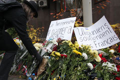 KIEV,UKRAINE - November 14, 2015: People lay flowers at the French Embassy in Kiev in memory of the victims terror attacks in Pari Royalty Free Stock Image