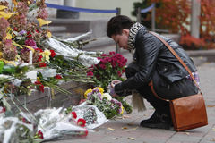 KIEV,UKRAINE - November 14, 2015: People lay flowers at the French Embassy in Kiev in memory of the victims terror attacks in Pari. People lay flowers at the royalty free stock images