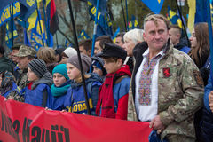 Kiev, Ukraine - October 14, 2016: Adherents of the Nationalist Party `Svoboda`. During nastviyaav honor of Defender of the Fatherland. On transporant slogan ` stock image