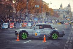 Automobile slalom and drift competitions in the city center, car on the road with cones. Kiev, Ukraine - October 22: automobile slalom and drift competitions in stock photo