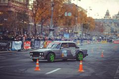 Automobile slalom and drift competitions in the city center, car on the road with cones. Kiev, Ukraine - October 22: automobile slalom and drift competitions in stock image