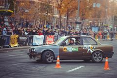 Automobile slalom and drift competitions in the city center, car on the road with cones. Kiev, Ukraine - October 22: automobile slalom and drift competitions in stock images