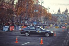 Automobile slalom and drift competitions in the city center, car on the road with cones. Kiev, Ukraine - October 22: automobile slalom and drift competitions in stock photography