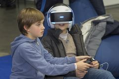 Kiev, Ukraine - 08 October 2017: Children get acquainted with the points of virtual finality at the exhibition of consumer electro. Nics CEE-2017 stock photography