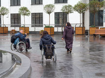 Kiev, Ukraine - October 24, 2015: Couple of people with disabilities in wheelchairs. To see the sights Royalty Free Stock Photography