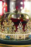 Golden crown with precious stones.  royalty free stock images