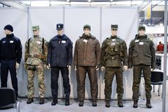 Modern tactical military equipment and weapons demonstrated at the exhibition Stock Image
