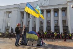 Kiev, Ukraine-October 10, 2017: Opponents of the acting President Petra Poroshenko and the cordon alone in front of the Verkhovna royalty free stock photography