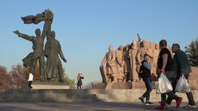 People on a walk at the Peoples` Friendship Arch in Kiev.
