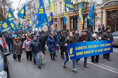 Kiev, Ukraine - October 14, 2016: The procession of supporters of the nationalist party `Svoboda`. On transporant slogan: `Bandera, Shuhavich - the hero of the stock photography