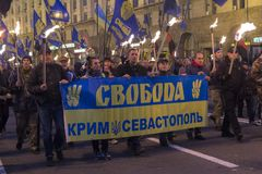 Kiev, Ukraine - October 14, 2017: Supporters of nationalist parties `Svoboda` during the march. On the anniversary of the creation of the Ukrainian army. The Royalty Free Stock Photo