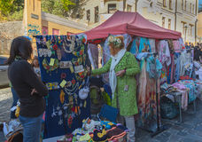 Kiev, Ukraine - October 03, 2015: Tourists and merchants in the market street St. Andrew's descent Royalty Free Stock Photos