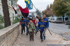 Kiev, Ukraine - October 14, 2016: Young supporters of the Nationalist Party `Svoboda`. With flags during nastviyaav honor of Defender of the Fatherland stock images