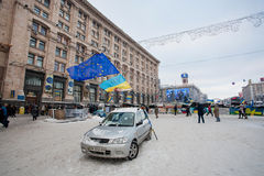 KIEV, UKRAINE: One car with national and EU flags on the empty snow street in the occupied territory by demonstrators. One car with national and EU flags on the Royalty Free Stock Images