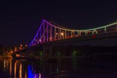 Kiev Ukraine pedestrian bridge evening illumination travel. Kiev Ukraine pedestrian bridge evening travel Stock Photo