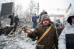 KIEV, UKRAINE: Protester in winter hat show grenad Royalty Free Stock Photos