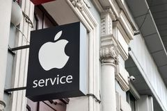 KIEV, UKRAINE – 19 September, 2018: Apple Store service logo at the street. Apple service lightbox with brand, logo royalty free stock images