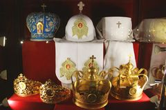 Crown and priests hats on a red background.  royalty free stock image