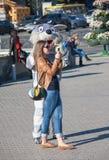 Kiev, Ukraine - September 9, 2013: Girl is photographed with an animator Stock Photography