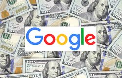Google logo printed on paper and put on money background stock photos