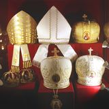 Headdresses of priests on a red background stock photo