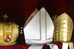Headdresses of priests on a red background stock image