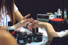 Kiev, Ukraine – 19 September, 2018: Manicure Master make gel nail extension during master-class at the beauty show. Beautician, acrylic, long royalty free stock photos