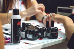 Kiev, Ukraine – 19 September, 2018: Manicure Master make gel nail extension during master-class at the beauty show. Kiev, Ukraine – 19 royalty free stock image
