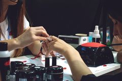 Kiev, Ukraine – 19 September, 2018: Manicure Master make gel nail extension during master-class at the beauty show royalty free stock images